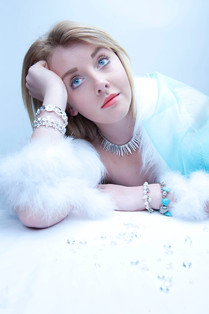 girl with jewellery and fur