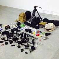 preparing equipment for photoshoot in afric
