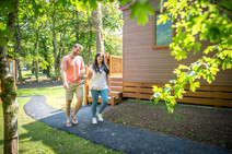 couple walking through holiday lodge park in cornwall
