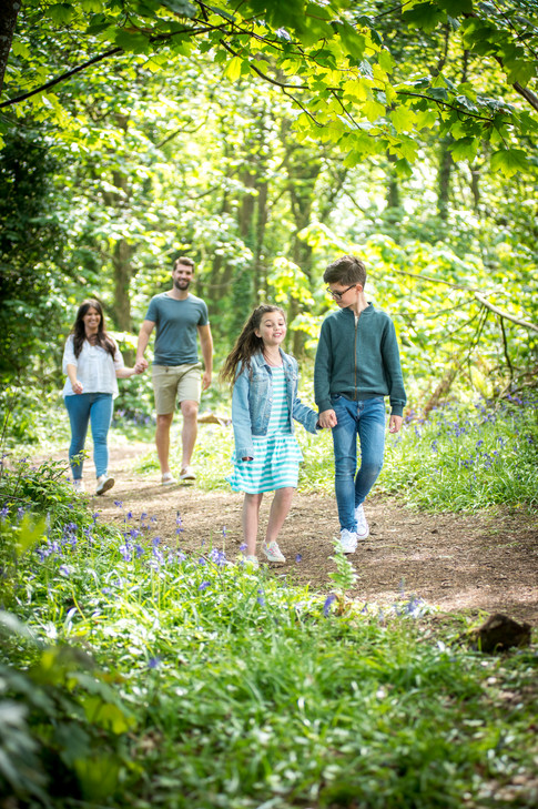 family walking in the woods at holiday park