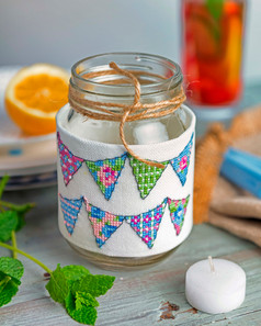 jam jar with cross stich covering