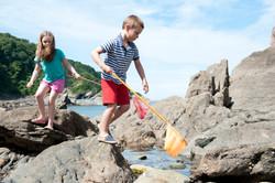 Kids in rock pools