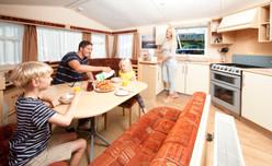 family in holiday caravan
