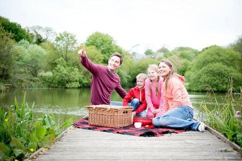 family picnic next to the lake