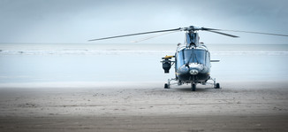 helicopter on beach fitted with canera mount