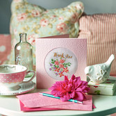 greetings card on table with tea cup