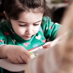 little girl concentrating at school