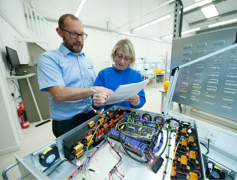 technicians in aerospace factory