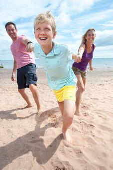 family on the beach in devon