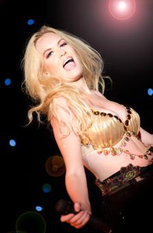 blonde singer on stage