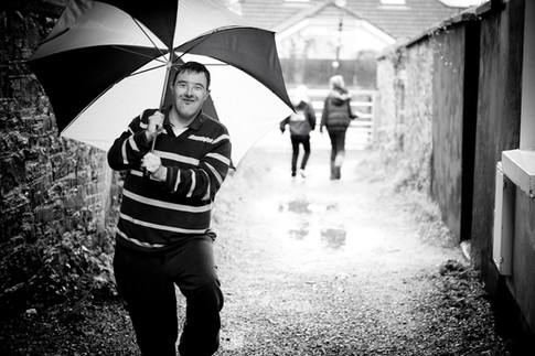 downs syndrome man with umbrella