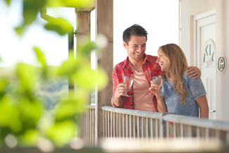 couple on balcony at holiday park