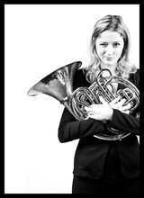 orchestra member with french horn