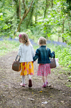 Young grils walking in the woods at a holiday park