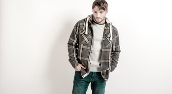 male fashion model against white background