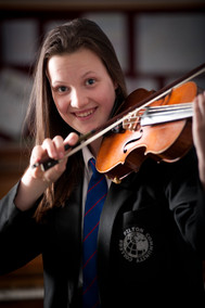 girl photographed playing the violin at school