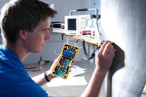 apprentice using test equipment
