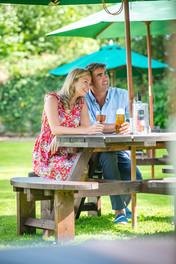 Couple enjoying a drink in a beer garden