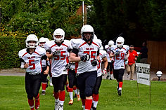Solent Thrashers Academy Junior team running out onto the pitch before a game