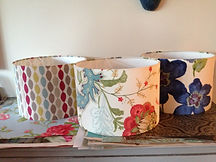 Lamp shades designed in different patterns - floral and geometric - at a sewing workshop in Northwich