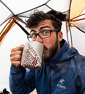 Photographer and guide, Tyler Gate, drinking coffee in his REI Half Dome Tent from is Snow Peak mug in his Arcteryx jacke.  Waiting out a storm while climbin in Patagonia, Argentina.
