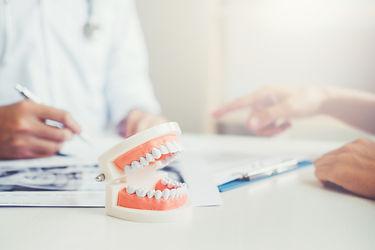 bigstock-Dentist-Talking-To-Male-Patien-