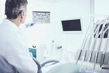 bigstock-Examining-Xray-Of-Teeth-Offic-2