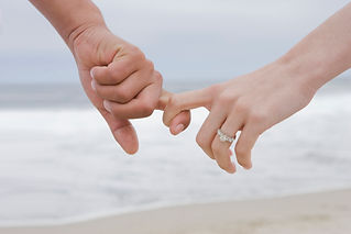 Couple holding hands on beach - LSR Family Law Group practice areas: Divorce - Northbrook, Chicago Suburbs