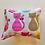 A single honeysuckle cuddle cushion decorated with a pink cat print placed on a white background