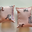 Two honeysuckle cuddle cushions with a peach and brown kitten print placed on a white background