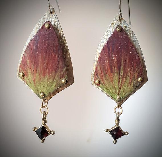 Shield earrings with garnet drop