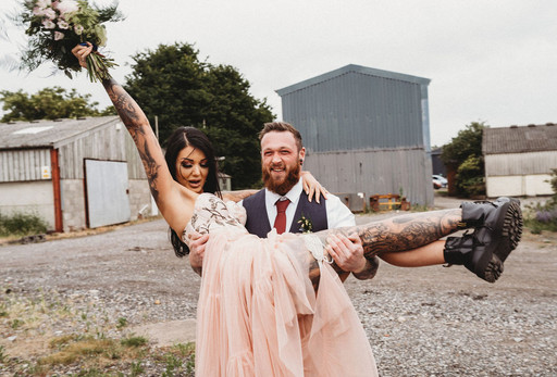 Alternative farm wedding at Sydenham Barn with a tattooed Bride and Groom