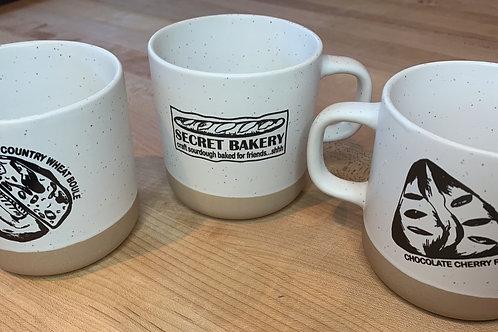 Secret Bakery Coffee Mug