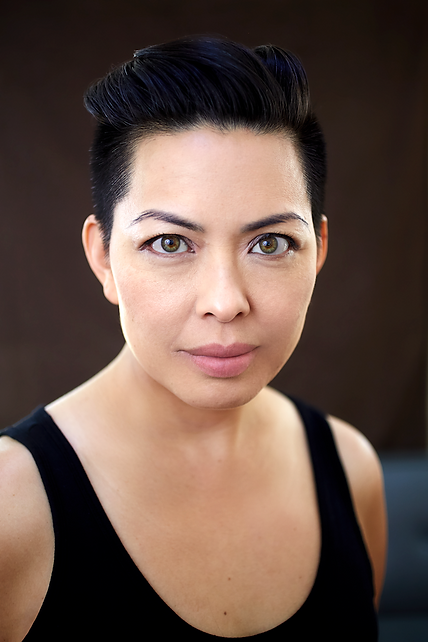 Asian American woman with short black hair looking directly at camera
