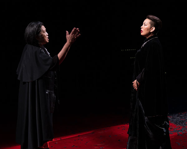Two Asian American women performing a scene from Shakespeare's Henry VI