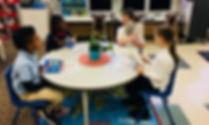 1.10 Kids working around table.jpg