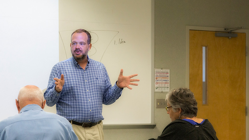 Eric Sheridan Wyatt, teaching a writing or literature class for adult learners.