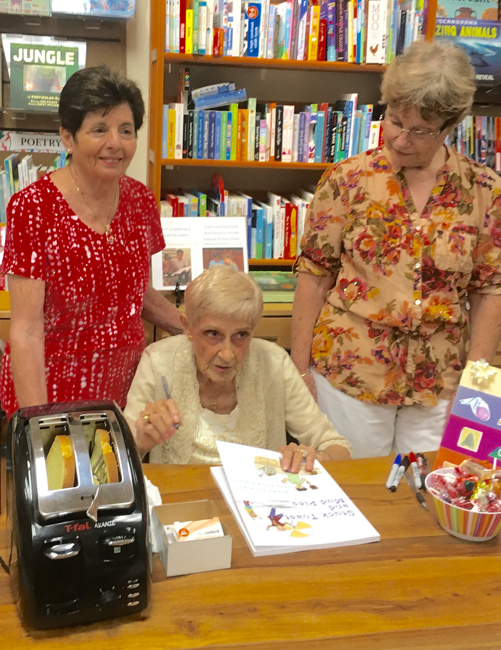 June Estep Fiorelli signs copies of her book, Stuck Toast and Mud Pies, at Bookstore One in Sarasota, Florida.