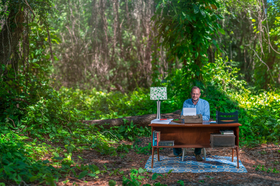 Author and teacher Eric Sheridan Wyatt, from a photoshoot with SRQ magazine, writing in the forest.