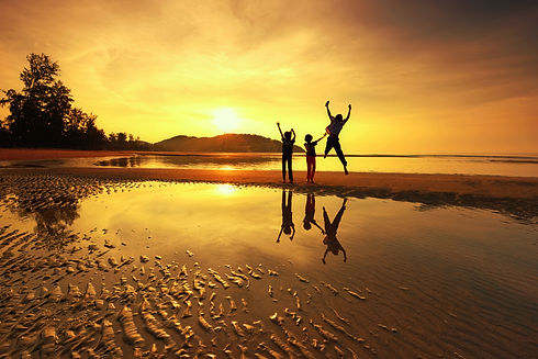 Silhouette of three kids playing on the beach at sunset.jpg Conceptual scene.jpg