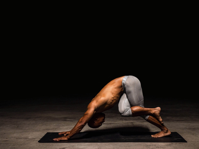 Leg Position of the Half Cow Face Pose in Downward Facing Dog Pose