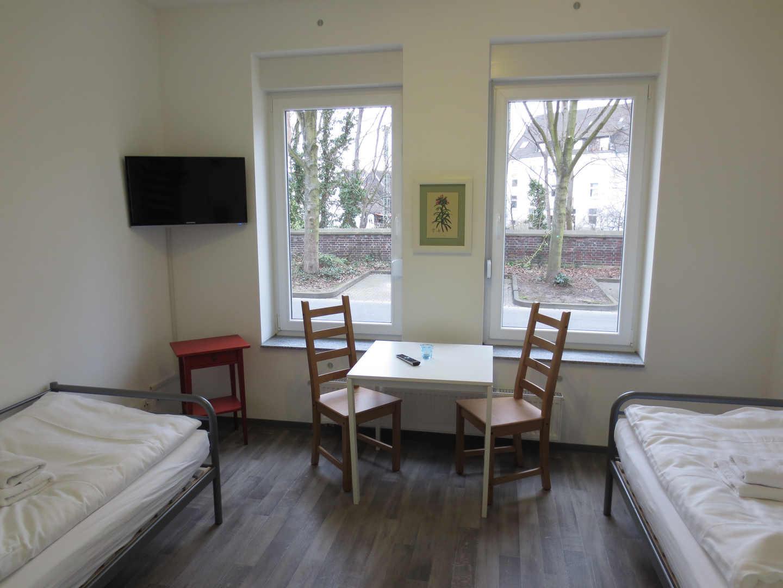 Schlafzimmer Ferienwohnung Pension Falke Dortmund