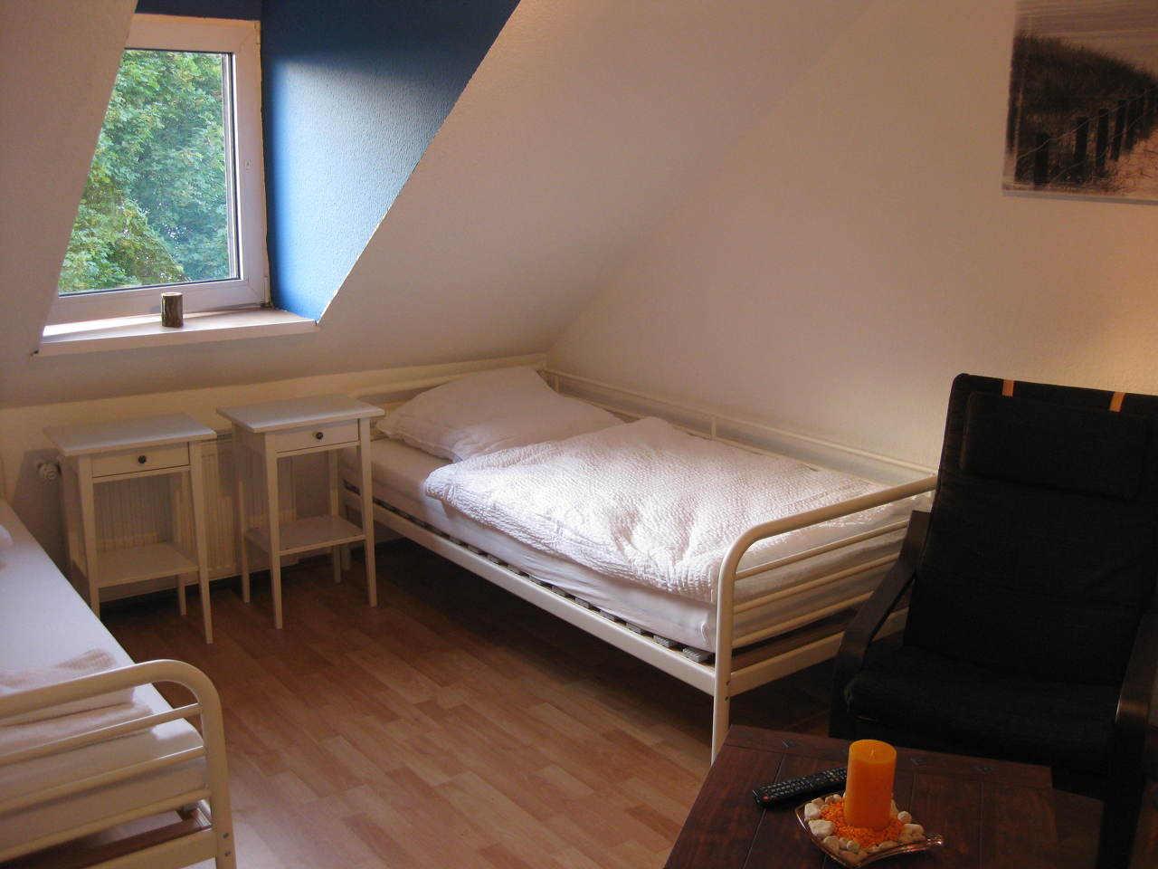 Schlafzimmer Ferienwohnung Pension Falke Dortmund Dachgeschoss
