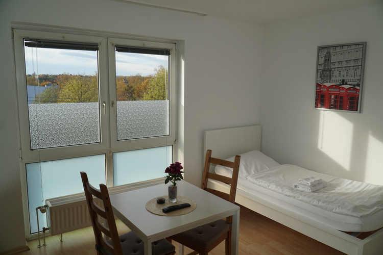 Schlafzimmer Ferienwohnung Pension Zufriedenheit Dortmund