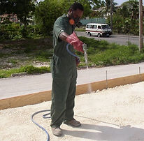 Kerry applying termicide to floor slab area