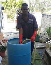 Grantley, mixing the termiticide in preparaton for injecting