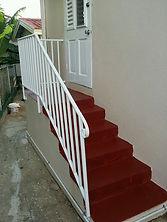 white wrought iron hand rails