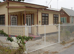 Chattel house with white PVC coated fence with BRC Double Drive gate.