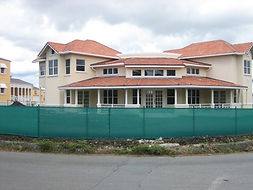 House building with the green privace screen.