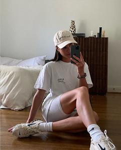 Sasha Mei wearing KIWA Studio's People for Wellness tee